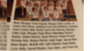 "image of photo caption in school yearbook showing the student named as ""Black Guy"""