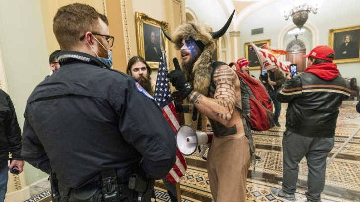 Trump supporters inside the Capitol being confronted by U.S. Capitol Police officers outside the Senate Chamber