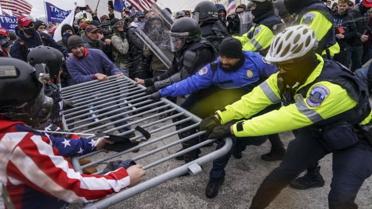 Pro-Trump protesters attempting to break through a police barrier at the Capitol in Washington