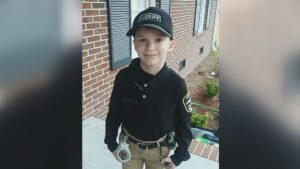 North Carolina second-grader Daniel Thigpen proudly wearing his sheriff's deputy outfit