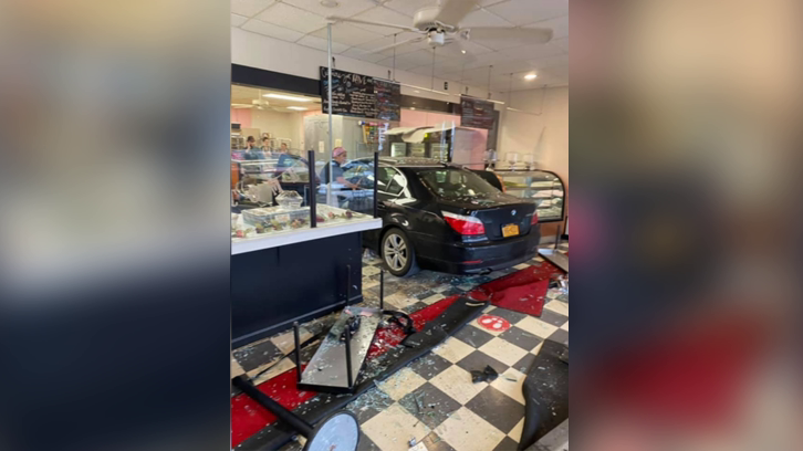 the 82-year-old woman's BMW inside the Dolce and Biscotti bakery in Clifton Park, New York, after it crashed through the front windows