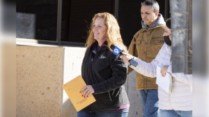 Jenny Cudd, a flower shop owner and former Midland mayoral candidate, and Eliel Rosa leaving the federal courthouse in Midland, Texas on Jan. 13