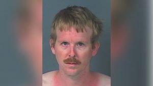 Police mugshot of Johnathan Rossmoine