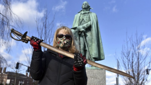 Cindy Gaylord, chairwoman of the Westfield Historical Commission, holding the original sword from the statue of Gen. William Shepard which stands near the town green in the center of Westfield, Mass.