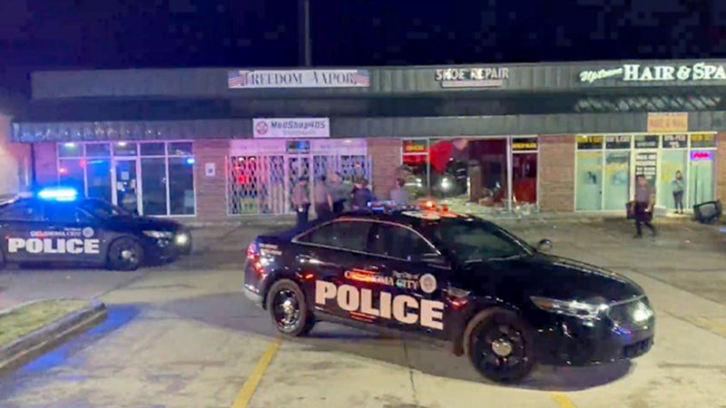 Police cars outside an Oklahoma City strip mall Wednesday night where a suspect hit the wrong building during an attempted ram-raid
