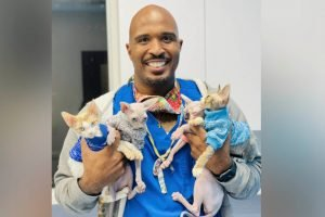 Florida vet Prentiss Madden in vets uniform holding animals
