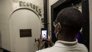 """The sign reading """"NEGROES"""" and its accompanying historical plaque at the Ellis County Courthouse in Waxahachie, Texas"""
