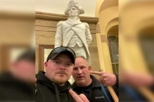 Rocky Mount police officers Jacob Fracker (left) and Thomas Robertson posing inside the Capitol in front of a statue