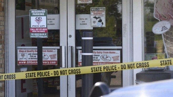 The scene outside the store in Windsor Township, Michigan, where Sean Ruis is believed to have stabbed a elderly man who confronted him about not wearing a mask