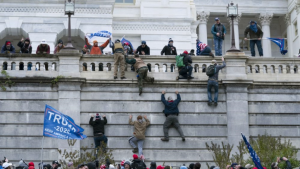 Trump supporters climbing the west wall of the U.S. Capitol on Wednesday, Jan. 6, 2021