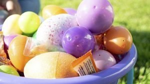 bucket of colored plastic Easter eggs