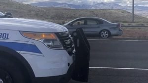 The Arizona highway patrol vehicle (foreground) which rammed the woman's Ford Taurus (background), finally causing her to stop