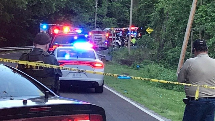 Emergency vehicles lining the road at the site of the young brothers' fatal crash in Jackson County, Missouri