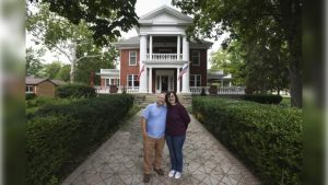 Kjersten and Greg Offenecker outside the Nordic Pineapple, their Civil War-era mansion turned bed and breakfast in St. Johns, Michigan