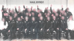 West Virginia prison officer cadets with blurred faces performing a Nazi salute
